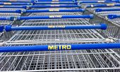 Samara, Russia - October 4, 2014: Large Empty Blue Shopping Cart Metro Store. Metro Group Is A Germa