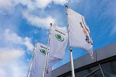 Samara, Russia - October 4, 2014: The Flags Of Skoda Over Blue Sky. Skoda Auto More Commonly Known A