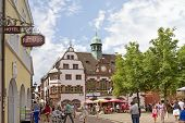 FREIBURG IM BREISGAU, GERMANY - AUGUST 6, 2014: Old town street in Freiburg, a city in the south-western part of Germany in the Baden-Wurttemberg state.