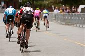 Cyclists Sprint Down Street In Duluth Criterium Event