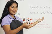 Hispanic teenaged girl in science class