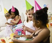 Multi-ethnic girls at birthday party