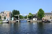 AMSTERDAM - JULY 26: A view of boats on the canal in harbor on 26 July 2014 in Amsterdam, The Netherlands.