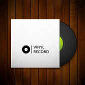 Black vintage vinyl record with blank cover case isolated on red wood texture background