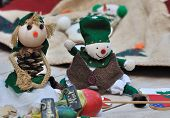 stock photo of rag-doll  - two small cloth dolls handmade for Christmas - JPG