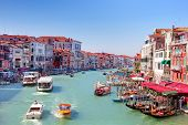 ITALY, VENICE - AUGUST 25 -  Gondolas and tourist boats traffic on the Grand Canal on August 25, 2014 in Venice, Italy. The entire city with its lagoon is listed on the World Heritage Site