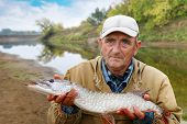 Old Fisherman And His Catch - Pike