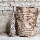 grunge wall, broom and old barrel