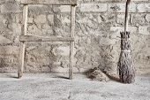 grunge wall, ladder and wooden broom
