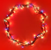 A circular border made with xmas lights. Space for text and headline.
