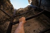 Old Metal Ladder, Blue Sky In The End And Male Hand