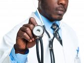 Doctor With A Stethoscope In The Hands On White