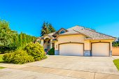 Luxury house with triple garage door in Vancouver, Canada.