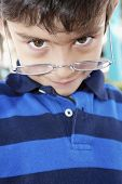 Hispanic boy wearing eyeglasses
