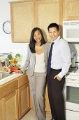 Asian couple in kitchen