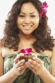 picture of pacific islander ethnicity  - Pacific Islander woman holding bath salts - JPG
