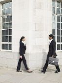 Multi-ethnic businesspeople walking around corner
