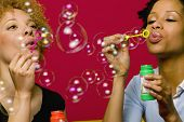 African women blowing bubbles