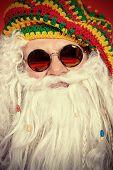 Close-up portrait of a casual Santa Claus hippie.