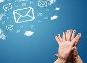 Happy cheerful smiley fingers looking at mail icons made out of clouds