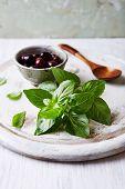 Fresh Basil and Kalamata Olives on a Chopping Board