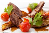 picture of roast duck  - Breast of Duck with Roasted Potato Slice and Cherry Tomatoes - JPG