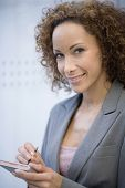 African businesswoman holding electronic organizer