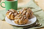 foto of eclairs  - Tasty eclairs on table with tea cup  - JPG