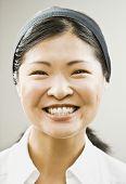 Close up of Asian woman wearing headband