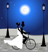Wedding couple ride a bicycle
