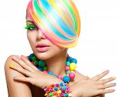 Beauty Girl Portrait with Colorful Makeup, Hair, Nail polish and Accessories. Colourful Studio Shot of Funny Model Woman. Vivid Colors. Manicure and Hairstyle. Rainbow Colors