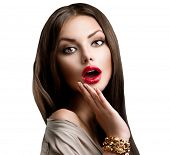 Beauty Surprised Brunette Woman isolated on White background. Beautiful Girl opening Mouth. Emotion. Red Lips and long smooth hair. Hairstyle. Makeup