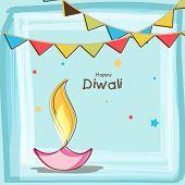 Illuminated oil lit lamp and stylish decoration for Diwali celebration on stylish sky blue background.