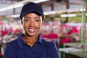 smiling female textile industrial worker in a factory