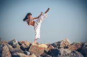 Young girl training karate