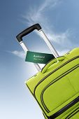 Auckland, New Zeland. Green Suitcase With Label