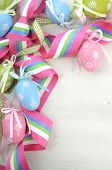 Happy Easter Background With Pink, Blue And Green Ornament Eggs And Ribbon On Vintage Style Rustic D