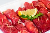 Raw Uncooked Beef Roulades On Plastic Market Box