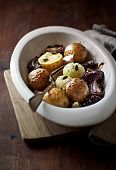 Autumnal potatoes and onions with garlic and green pumpkin seeds