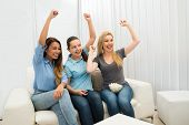 Three Young Women Cheering