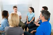 foto of motivation talk  - People Listening To A Man Gesturing With Hands - JPG