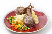 Lamb chops on a bed of potato with mixed vegetables