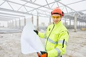 picture of engineering construction  - male engineer construction foreman manager outdoors indoors at building site with blueprints - JPG