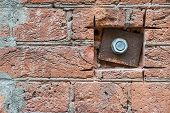 Iron Plate And Nut On A Old Brick Wall