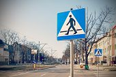 Retro Filtered Photo Of Pedestrian Crossing Signs.