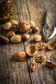 picture of nutcracker  - steel nutcracker and nuts of various kinds nuts in honey - JPG