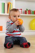 Baby Boy Child Eating Orange Fruit