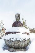 Buddha Scalpture With A Snow At Higashiyama Temple in Takayama