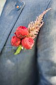 picture of boutonniere  - Pinning a Boutonniere for groom during his wedding - JPG
