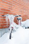 Frozen bike covered in ice